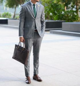 1-green-tie-and-checked-gray-suit