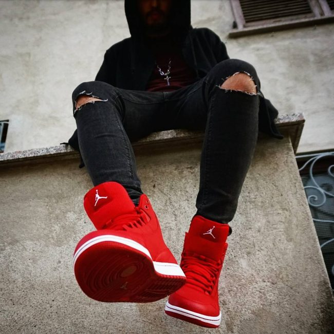 10 Black Ripped Jeans with Red Air Jordan Shoes