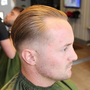 12 Silky Smooth Slick Back with Low Fade