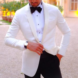 13-tie-and-a-white-tuxedo-coat-clashed-with-black-trousers