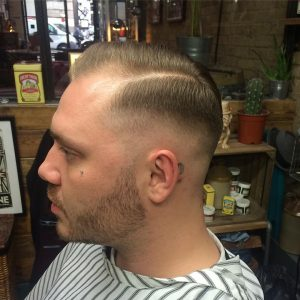 19 Pomp with Low Skin Fade