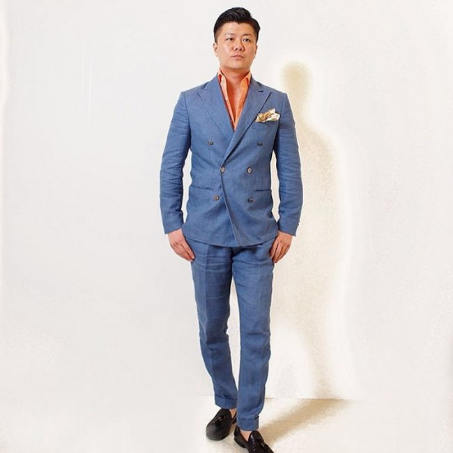 2-blue-crossed-lifted-suit