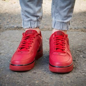 2 Red Sneakers Shoes with Blue Jeans