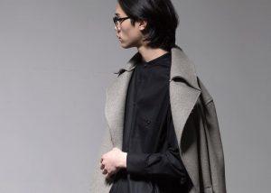20 Long Trench Coat and Black Shirt