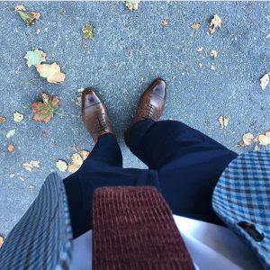24 Shiny Brown Shoes with a Checked Coat
