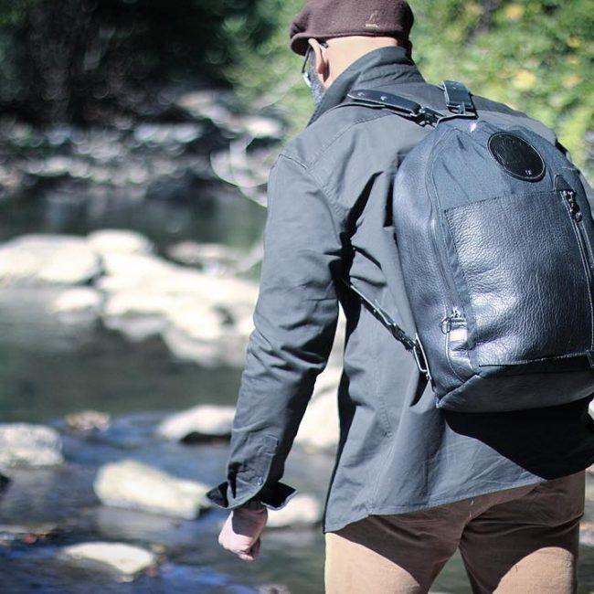 25 Designer Black Backpack & Faded Jeans Pants