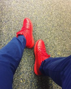 4 Red High Tops with Blue Jeans