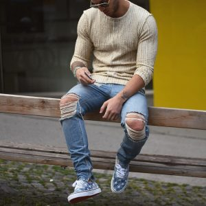 40 Sweater Top and Distressed Jeans Combination