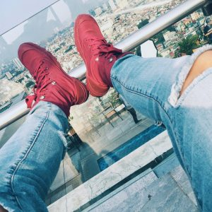 6 Ripped Jeans with Red Sneakers
