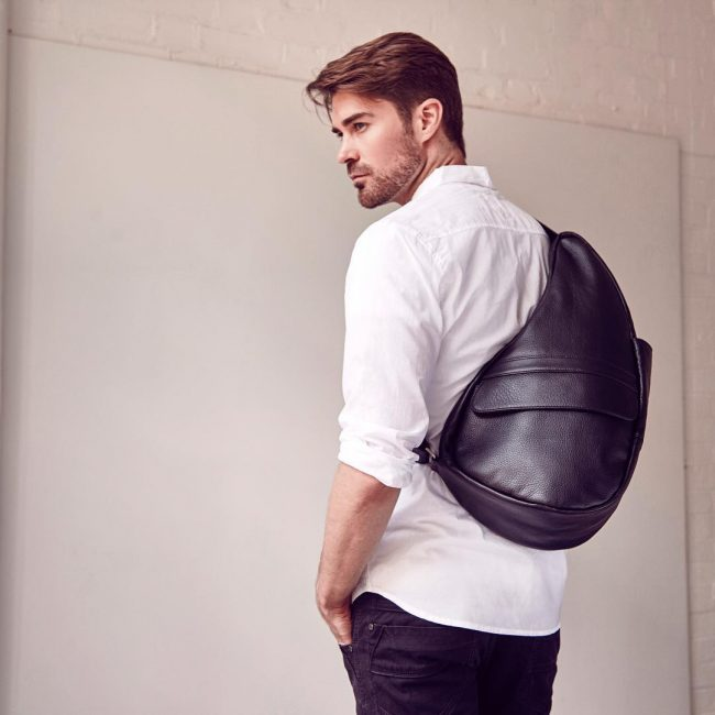 8 Black Backpack & White Shirt