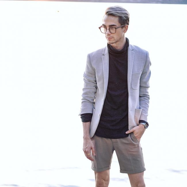 13 A Blazer and Grey Shorts