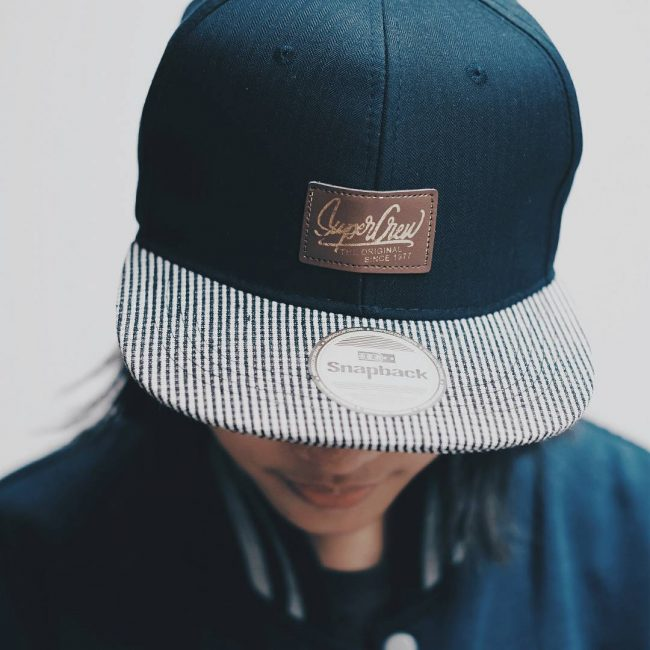 4 Dark Colored Constructed Cap with a Striped Brim