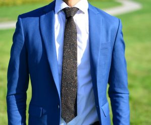 7 Brown Floral Tie & Fitting Blue Suit